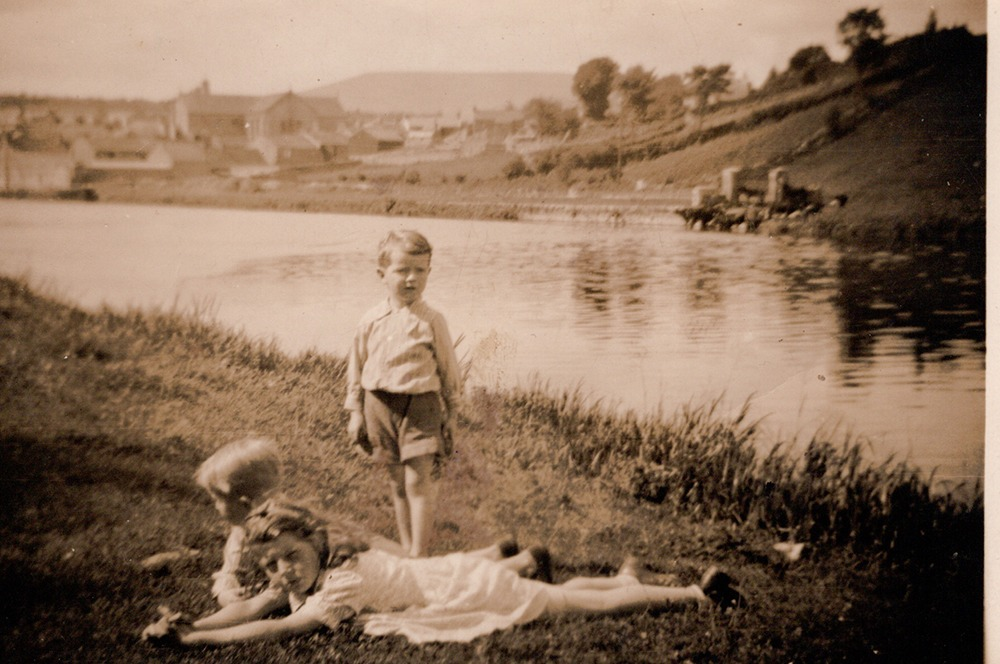 Greta Sean and Liam Carley children lying by bank of river barrow.png